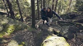 Couple of backpackers hiking together Stock Footage