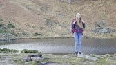 Content girl with backpack in nature Stock Footage