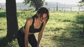 yorgunluk : Fit active woman exercising outdoors in park on sunny day.