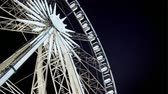 dairesel : Looking up at an illuminated rotating ferris wheel Stok Video