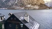 hostel : Rooftops on rural houses placed on coast of cold lake in Hallstatt among rocky mountains, Austria
