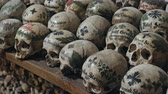 кресты : Hallstatt, Austria - December 27, 2017: Skulls painted with names, colorful flowers and crosses in the Charnel House or Beinhaus, Hallstatt, Austria