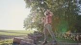 popa : Brutal lumberjack with axe in sunlight - slow motion