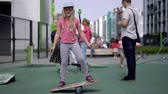 strengthen : life in a modern city - a girl rides a balance-board on an advanced playground