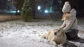 лабрадор : happy life of pets in the family. beautiful girl stroking her dog outdoors in winter.