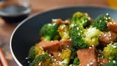 ground meat recipes : Broccoli and beef cooked on olive oil Stock Footage