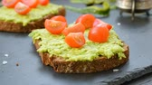 diet : Toast with avocado, cherry tomatoes and spices Stock Footage