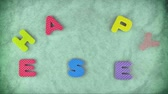 Message Happy Easter appearing randomly letter by letter with the green texture for background