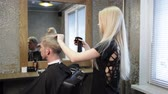 drench : Woman barber  maiking mans haircut Stock Footage
