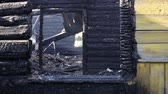 firebrand : The effects of a fire in a wooden house, the ashes Stock Footage