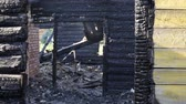firebrand : Burned wooden house, charred logs