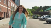 road roller : Beautiful young woman smiling and riding on roller skates in city Stock Footage