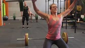 snatch : Group of fitness people doing power weight lifting workout in gym