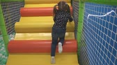 Kid climbing on stairs in childrens play center