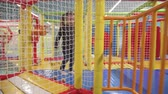 Girl playing and having fun on playground in childrens center indoors