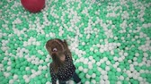 Child moves on small balls in play center