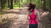 Fitness woman run in spring sunny forest