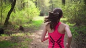 Active woman running in spring sunny forest Stok Video