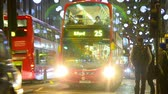 atrair : Oxford Street at night before Christmas with Traffic and people walking in London, United Kingdom Stock Footage