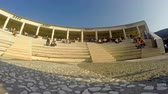 kosmos : Timelapse of Visitors at Thessaloniki Mediterranean Cosmos mall taking break and meal at amphitheater stairs. Panning timelapse of commuters shopping.