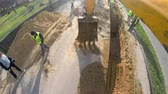 heavy : UHD backhoe tractor works on a construction site. Bulldoger worker pov Stock Footage