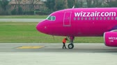 construir : Wizzair aircraft check up before take off on runaway prior to departure at an airport. UHD 4K stock footage