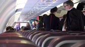 interior : Commuter aircraft passengers getting ready for take off. UHD stock footage