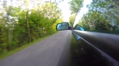 Timelapse of Fast driving Sport Car with reflection in the mirror- Point of View, Trees on the side. UHD 4K stock footage