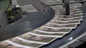Newspapers flow along an assembly line in a newspaper print factory. UHD 4K stock footage
