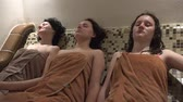 people : Three family female enjoy spa sauna steam bath. UHD steadycam 4K stock footage
