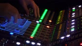decibels : 4k Hand of the sound producer adjust audio on music concert at dark atmosphere