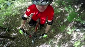 bike ride : MTB Mountain bike downhill racer riding fast in the forrest, 4k head mount camera