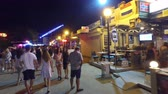 stink : Night Walk Pov of Sunny Beach with people walk along the central street with Restaurants, Bars, Dischoteques, Shops