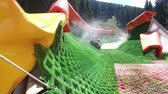 rubber tubing : Tourist enjoy having fun at summer Tubing Park in Bansko, Bulgaria Stock Footage