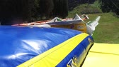 baloon : Summer tubing slide takes children down and jump at inflatable baloon bed