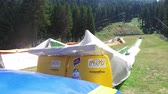 rubber tubing : Summer Tubing atraction Park with jump replaces winter snow sliding Stock Footage