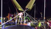 categoria : Girl jumping on the bungee trampoline in amusement park