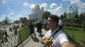 кресты : Tourist selfie praying on Cathedral Square in Holy Trinity Seraphim-Diveevo monastery in village of Diveevo, Russia