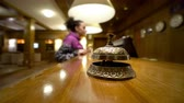 duyurmak : Arrival to hotel. Selective focus on smooth little bell standing on reception counter desk Stok Video