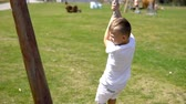 Boy swinging on rope outdoors in Slow Motion