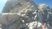 gezi : Mountaineer pov to expedition climbing to rocky mountain summit Triglav on Julian Alps mountain range Stok Video