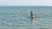 sable : Beautiful teen walking out of sea water