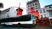 румяна : The Moulin Rouge cabaret at twilight and public transportation in Slow Motion in Paris, France.