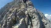 góral : Mountaineer pov to expedition climbing to rocky mountain summit Triglav on Julian Alps mountain range Wideo