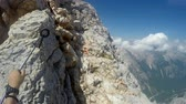 montanhas rochosas : Mountaineer pov to expedition climbing to rocky mountain summit Triglav on Julian Alps mountain range Stock Footage