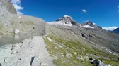 góral : Panorama of mountain lake and range near Vittorio Emanuele II Refuge hut on expedition to Gran Paradiso summit on Italian Alps