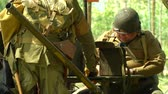 csatatér : US soldiers at command post during a WWII reenactment on 18 may 2014 in Signa, Italy Stock mozgókép
