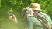 csatatér : German soldiers on a battlefield during a WWII reenactment on 18 may 2014 in Signa, Italy