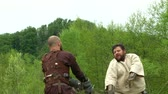 celta : A duel between two Gaelish warriors during a reenactment on May 3, 2014 in Masserano, Italy Vídeos