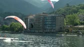 wing : Paragliders spiraling over lake (in slow motion) during AcroAria, the legendary acrobatic paragliding world cup hosted in the scenic Lake Orta, 5 July 2014 - Omegna (Italy)